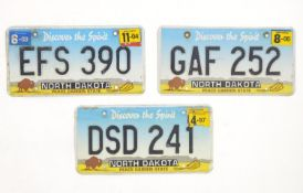 A quantity of late 20thC / 21stC examples of American state license / number plates, North Dakota,