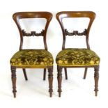A pair of 19thC mahogany balloon back side chairs, with carved mid rails above shaped upholstered