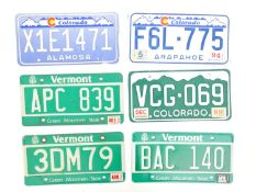 A quantity of late 20thC / 21stC examples of American state license / number plates, comprising
