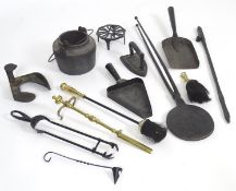 A quantity of assorted 19thC and later fire tools etc. to include a cast iron waffle iron, a cast