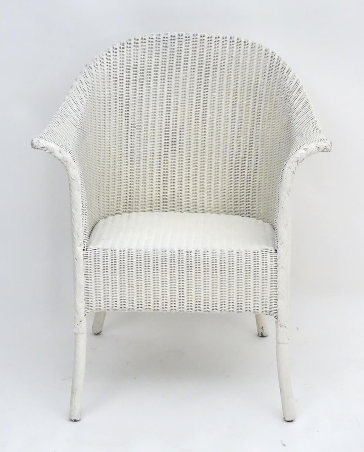 An early 20thC LLoyd loom armchair with a white painted bentwood frame. Bearing label to underneath. - Image 3 of 6