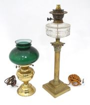 An early 20thC table oil lamp converted to electricity with a Corinthian column brass base. Together