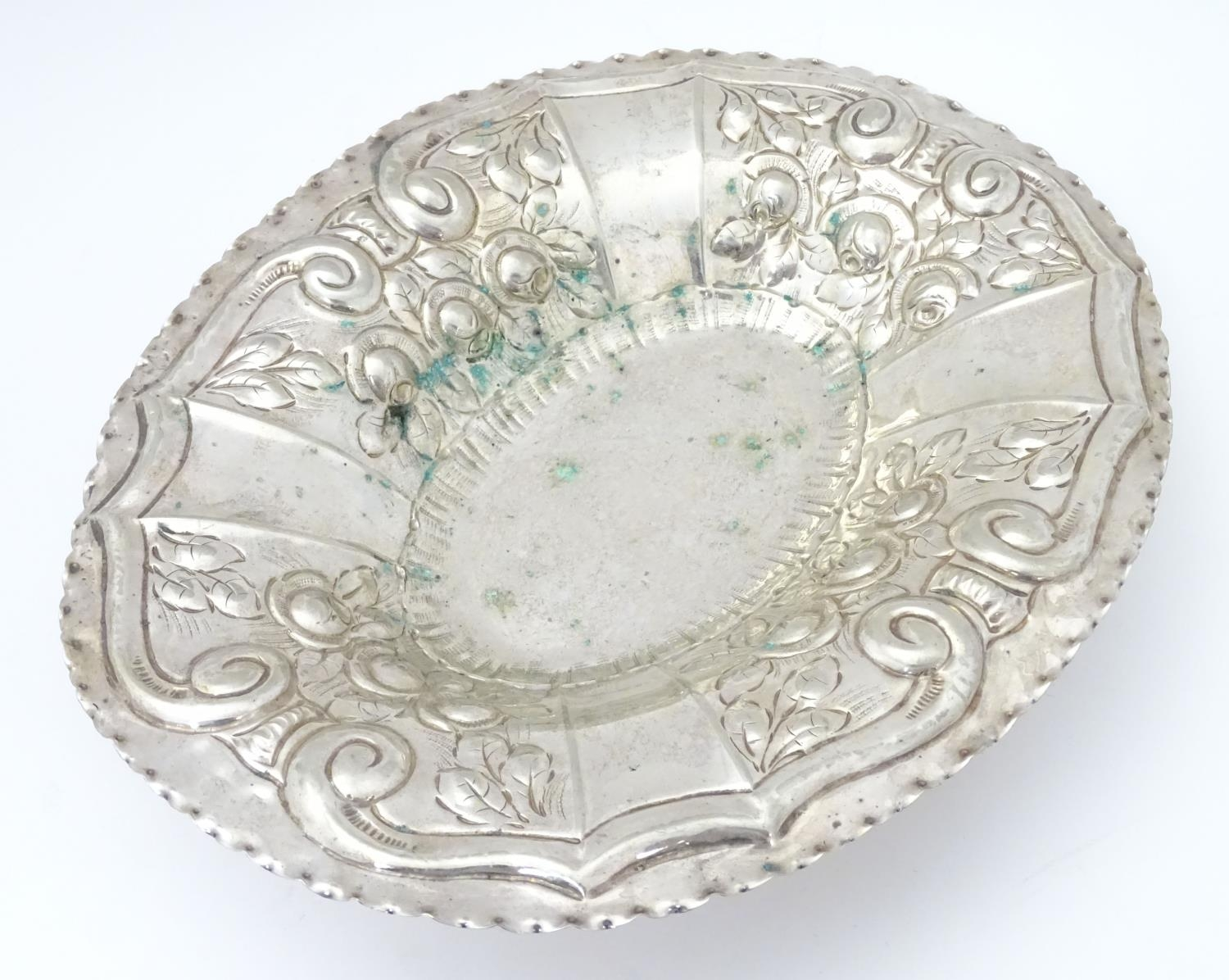 """A silver plate dish of oval form with embossed decoration. Approx. 12"""" wide. Please Note - we do not"""