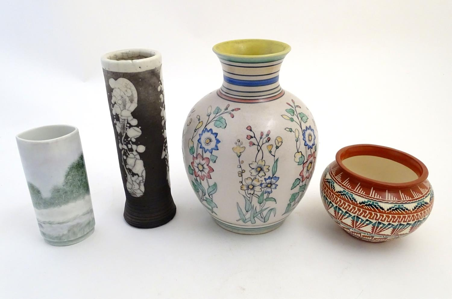 Four assorted vases, comprising A New Mexico Navajo studio pottery squat vase with incised banded