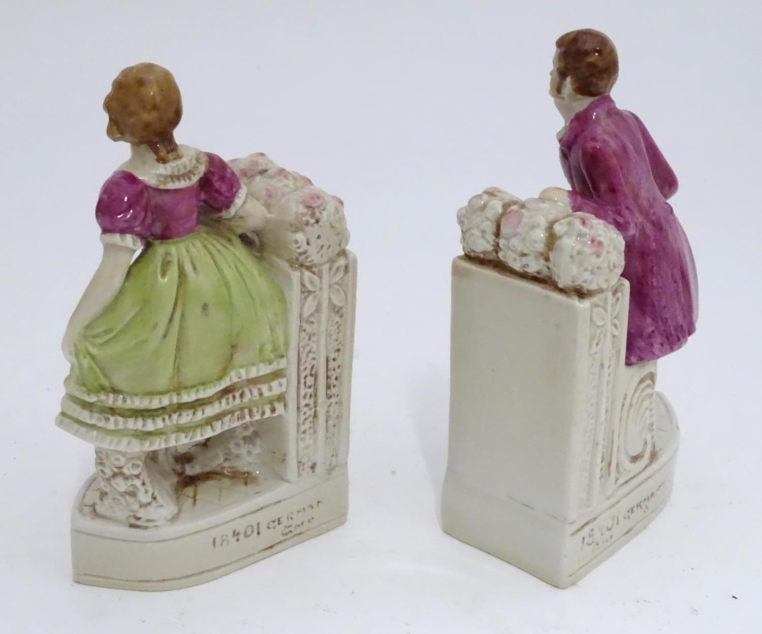 A pair of German porcelain figural bookends depicting a gentleman and a lady with flowers. Marked - Image 11 of 13