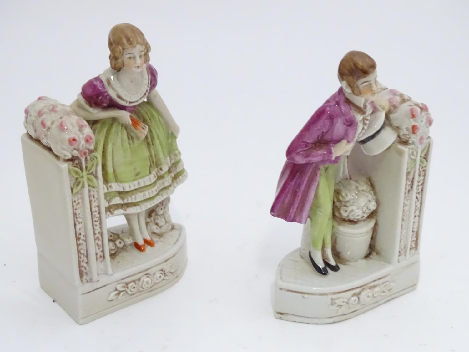 A pair of German porcelain figural bookends depicting a gentleman and a lady with flowers. Marked - Image 6 of 13