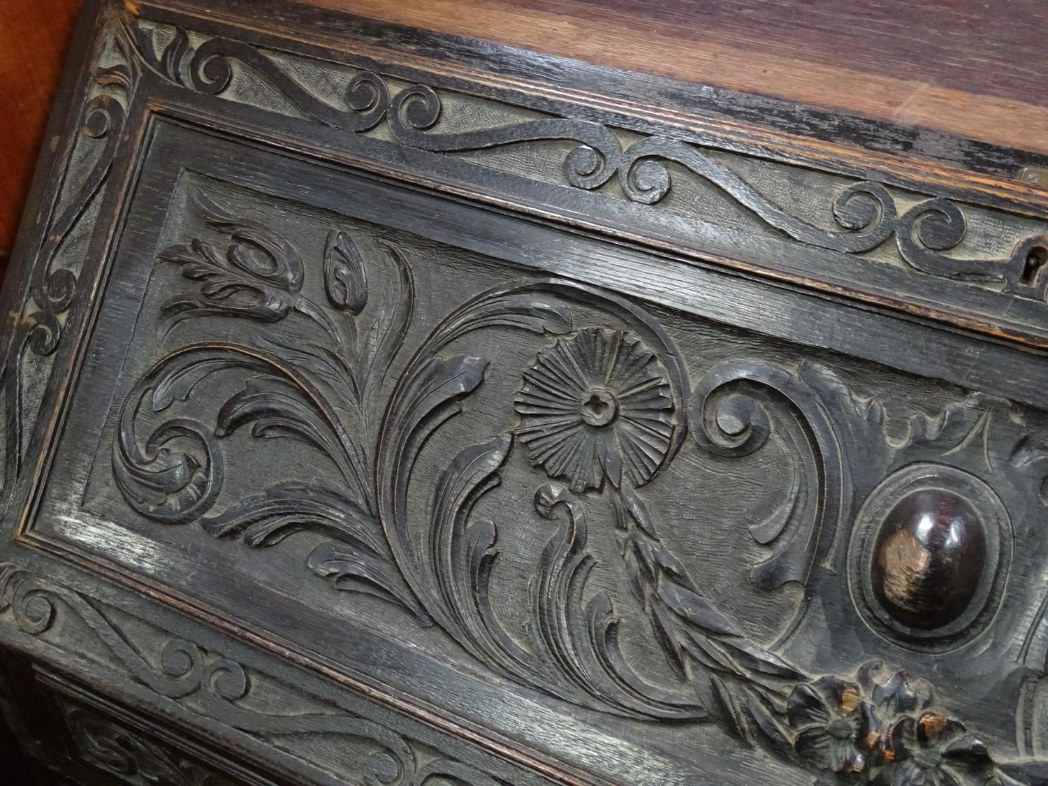 A 19thC carved oak bureau Please Note - we do not make reference to the condition of lots within - Image 2 of 4
