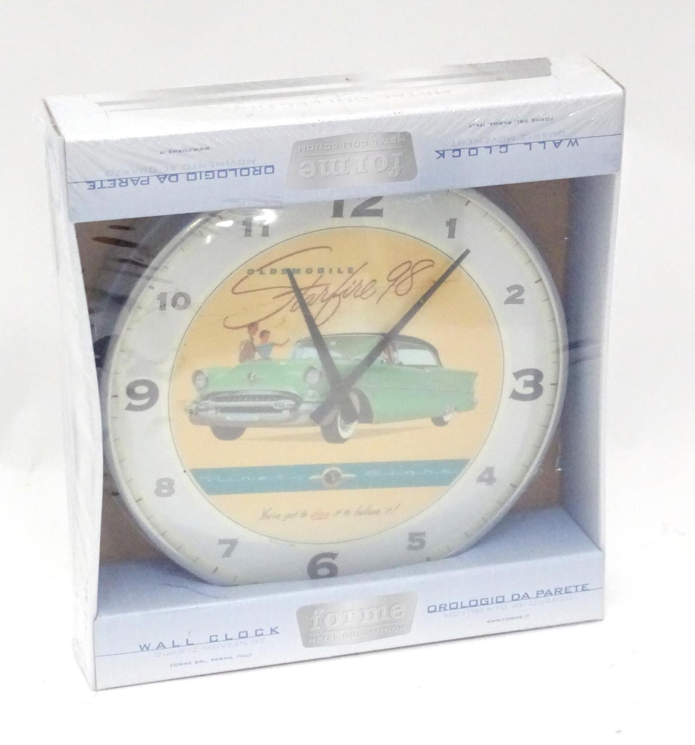 An American motoring wall clock decorated with the car / vehicle Oldsmobile Starfire '98 Please Note