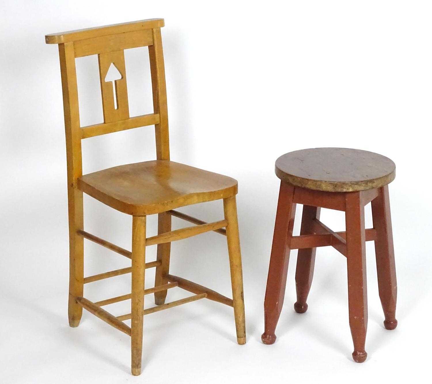 An early 20thC pine stool together with a chair having a shaped top rail and pierced back splat.