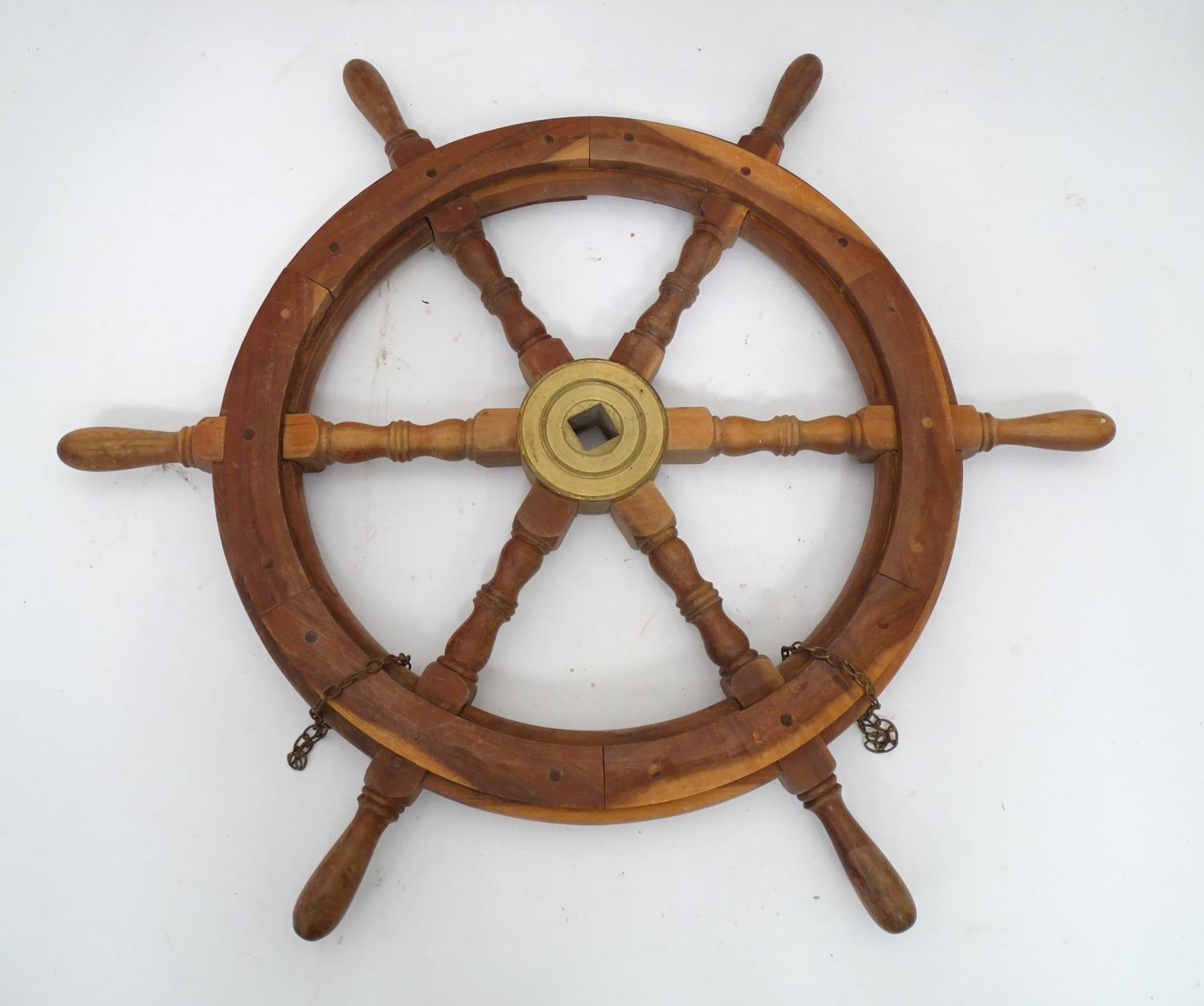A teak and brass ships wheel Please Note - we do not make reference to the condition of lots