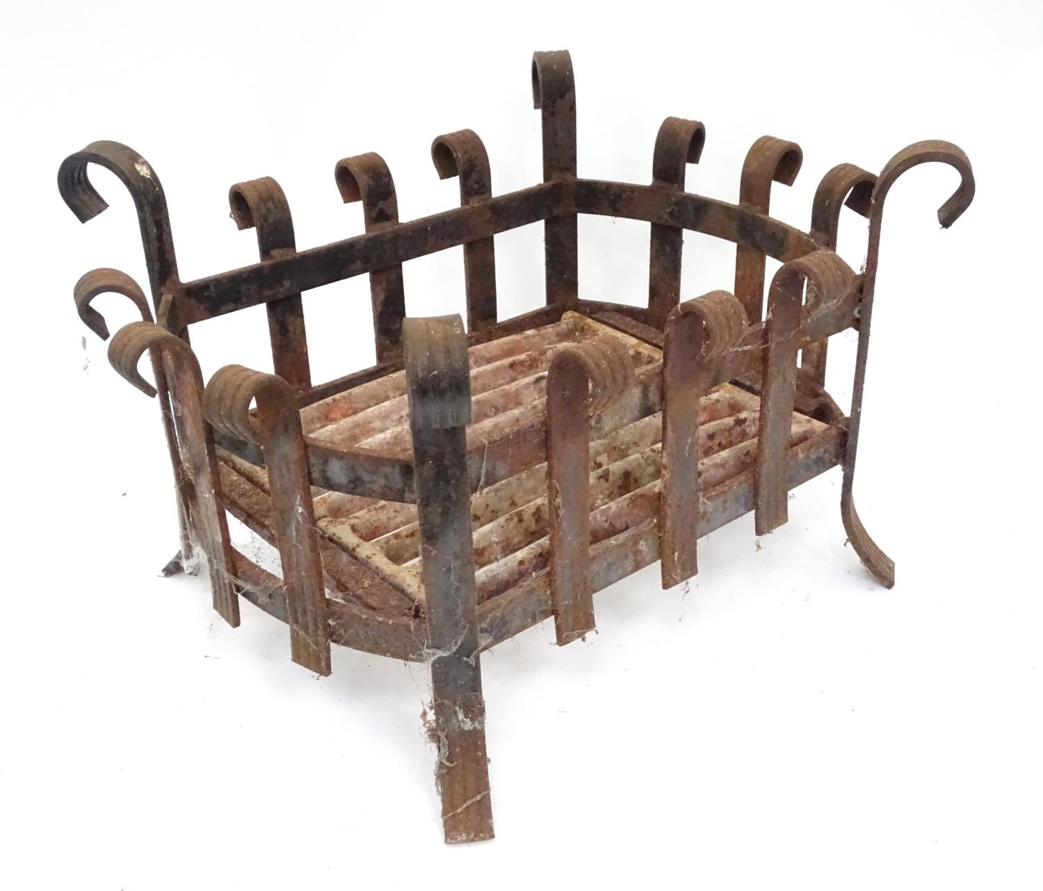 A cast iron fire basket with scroll decoration Please Note - we do not make reference to the