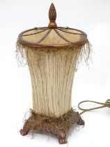 A lamp of trumpet form with upholstered body and shade Please Note - we do not make reference to the