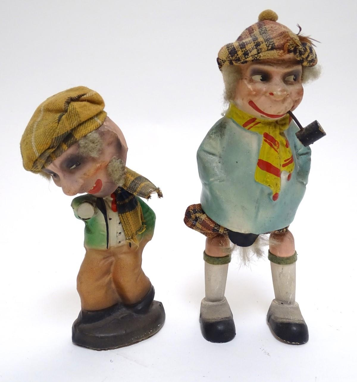 Toys: Two unusual novelty humorous Scottish figures made of pressed card. A wind up toy modelled