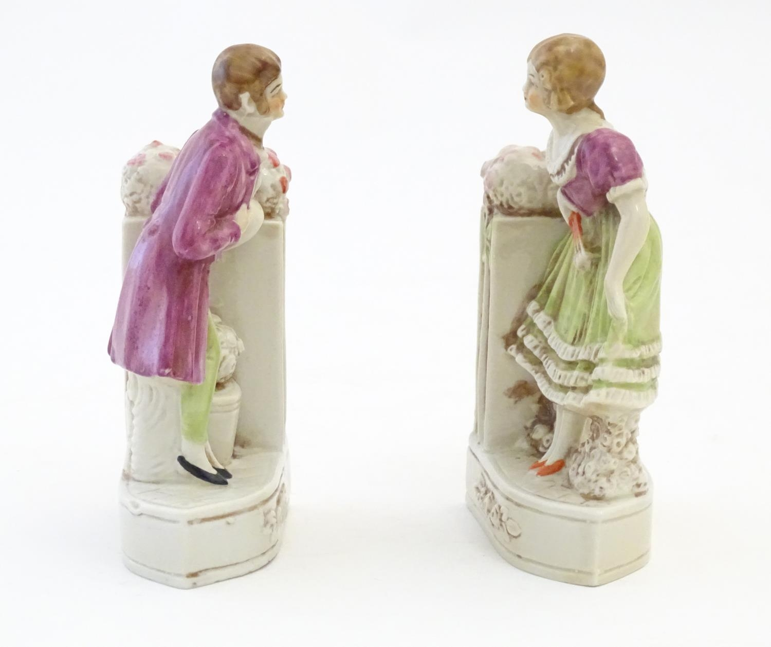 A pair of German porcelain figural bookends depicting a gentleman and a lady with flowers. Marked - Image 9 of 13