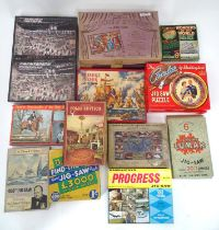 A quantity of vintage puzzles Please Note - we do not make reference to the condition of lots within