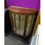 A glazed demi lune walnut display cabinet Please Note - we do not make reference to the condition of
