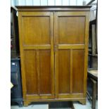 An early 20thC oak wardrobe Please Note - we do not make reference to the condition of lots within