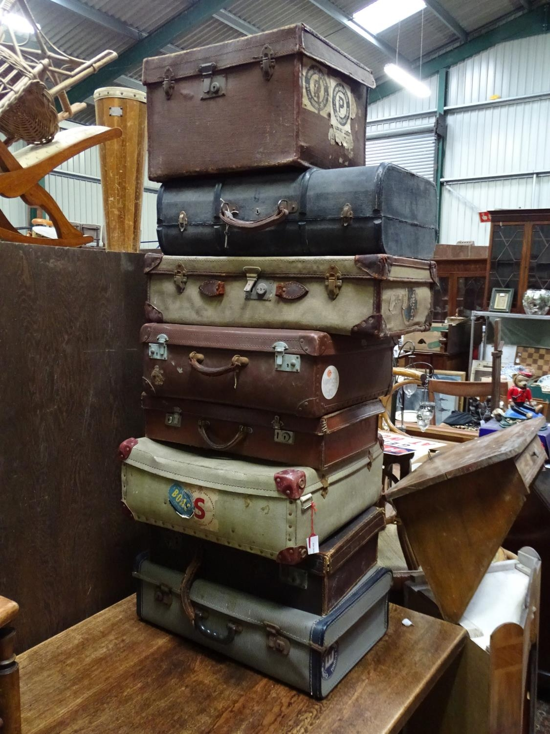 Eight vintage trunks / suitcases with old tourist labels (8) Please Note - we do not make