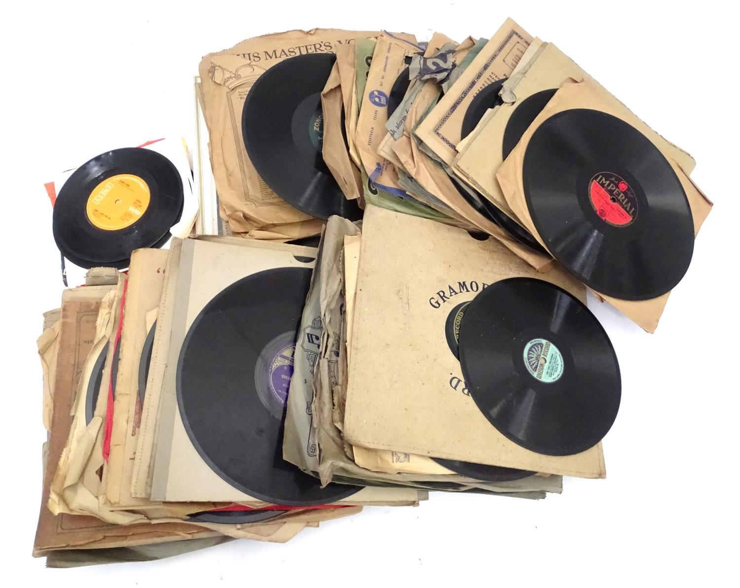 An oak cased wind up gramophone. Together with a quantity of records Please Note - we do not make - Image 6 of 13