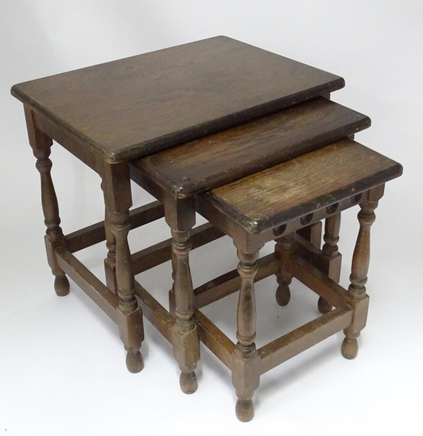 An oak nest of tables Please Note - we do not make reference to the condition of lots within