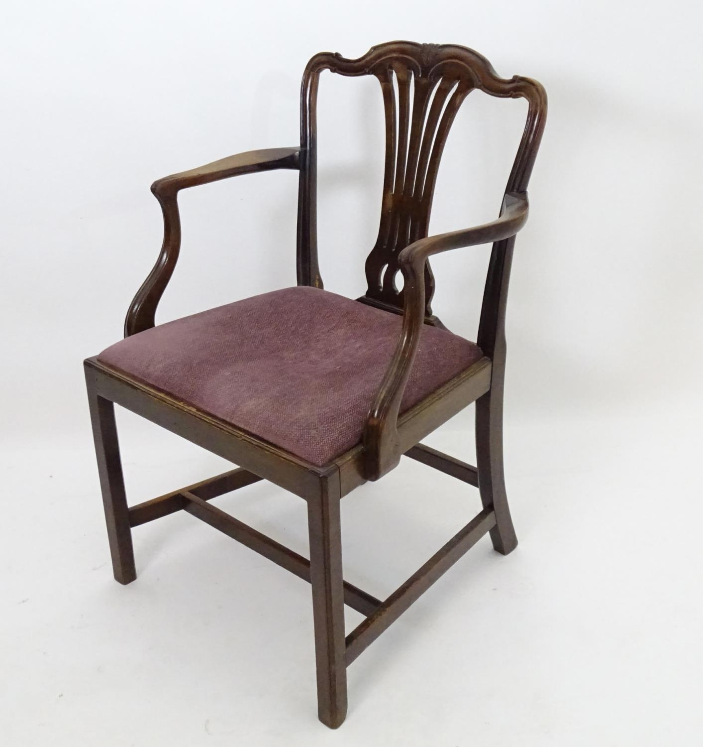 A 19thC mahogany carver chair with upholstered seat Please Note - we do not make reference to the