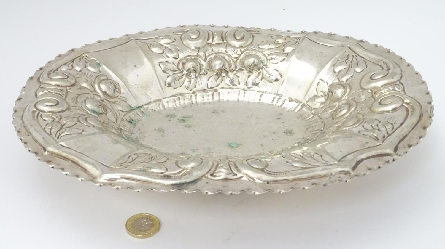 """A silver plate dish of oval form with embossed decoration. Approx. 12"""" wide. Please Note - we do not - Image 4 of 5"""