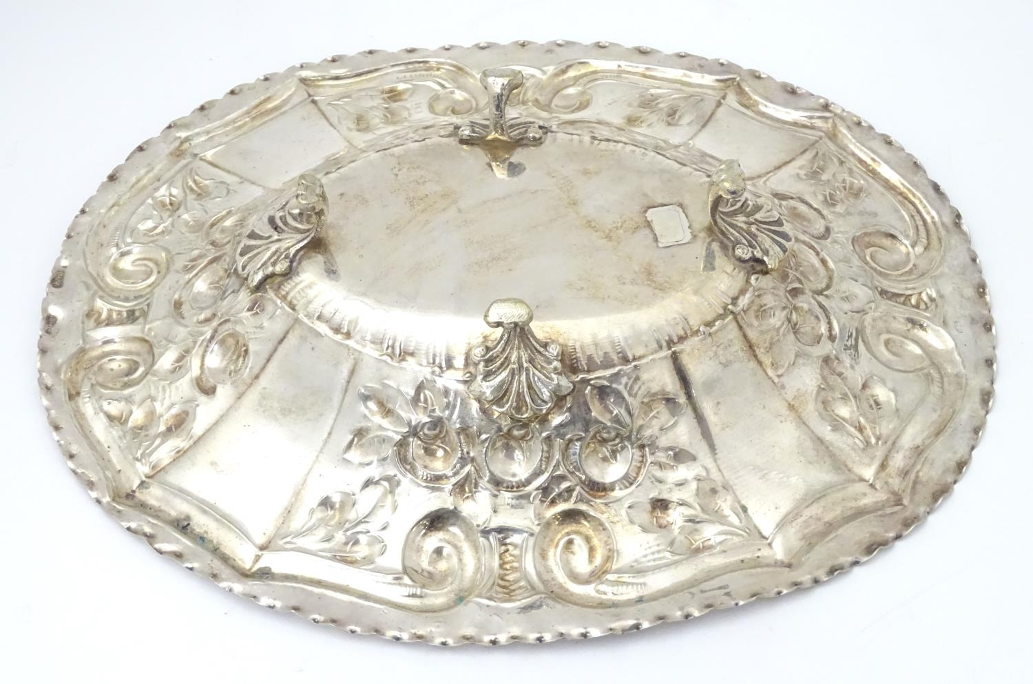 """A silver plate dish of oval form with embossed decoration. Approx. 12"""" wide. Please Note - we do not - Image 5 of 5"""