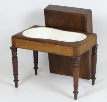 """A Georgian mahogany bidet with a rectangular lid above four turned tapering legs. 22"""" wide x 14"""""""