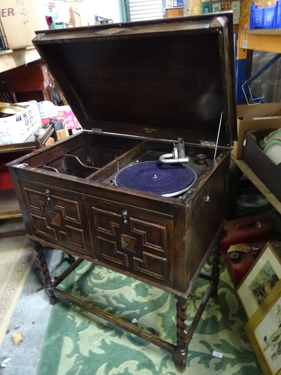 An oak cased wind up gramophone. Together with a quantity of records Please Note - we do not make - Image 2 of 13