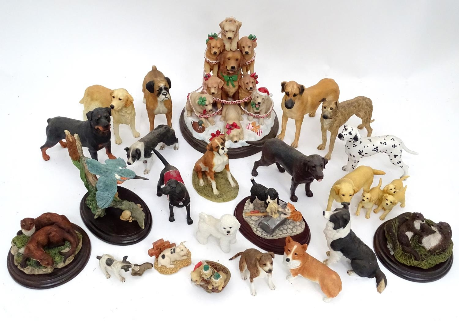 A quantity of dog figurines Please Note - we do not make reference to the condition of lots within