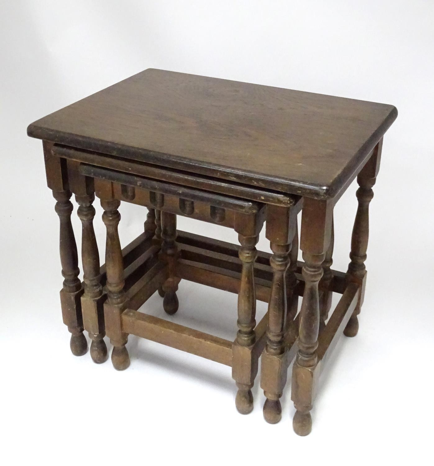 An oak nest of tables Please Note - we do not make reference to the condition of lots within - Image 3 of 3