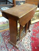 """A Cotswold school style oak drop flap table with a chamfered frame and exposed construction. 30"""""""