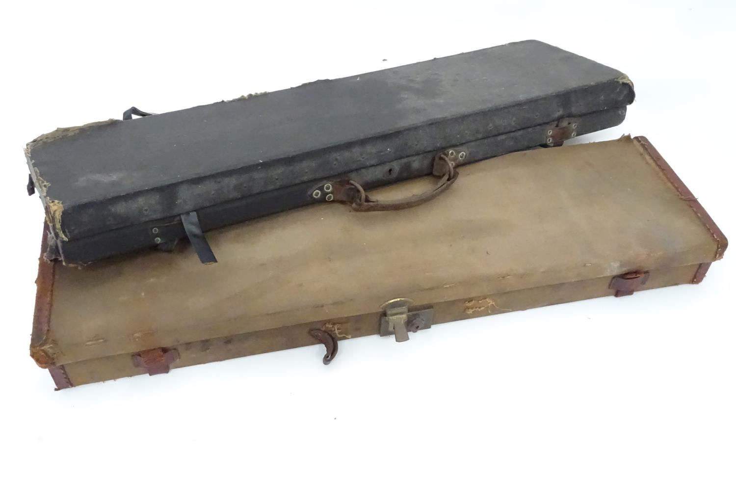 """A Victorian shotgun motor case for 31"""" barrels, the exterior with black leather finish, the interior"""