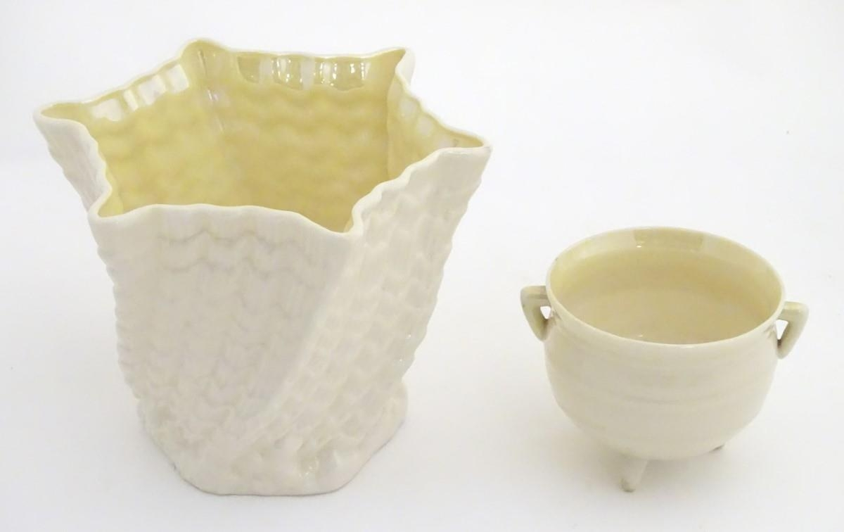 Two Belleek Ireland pottery wares, comprising a twisted lustre shell vase / flower pot with a