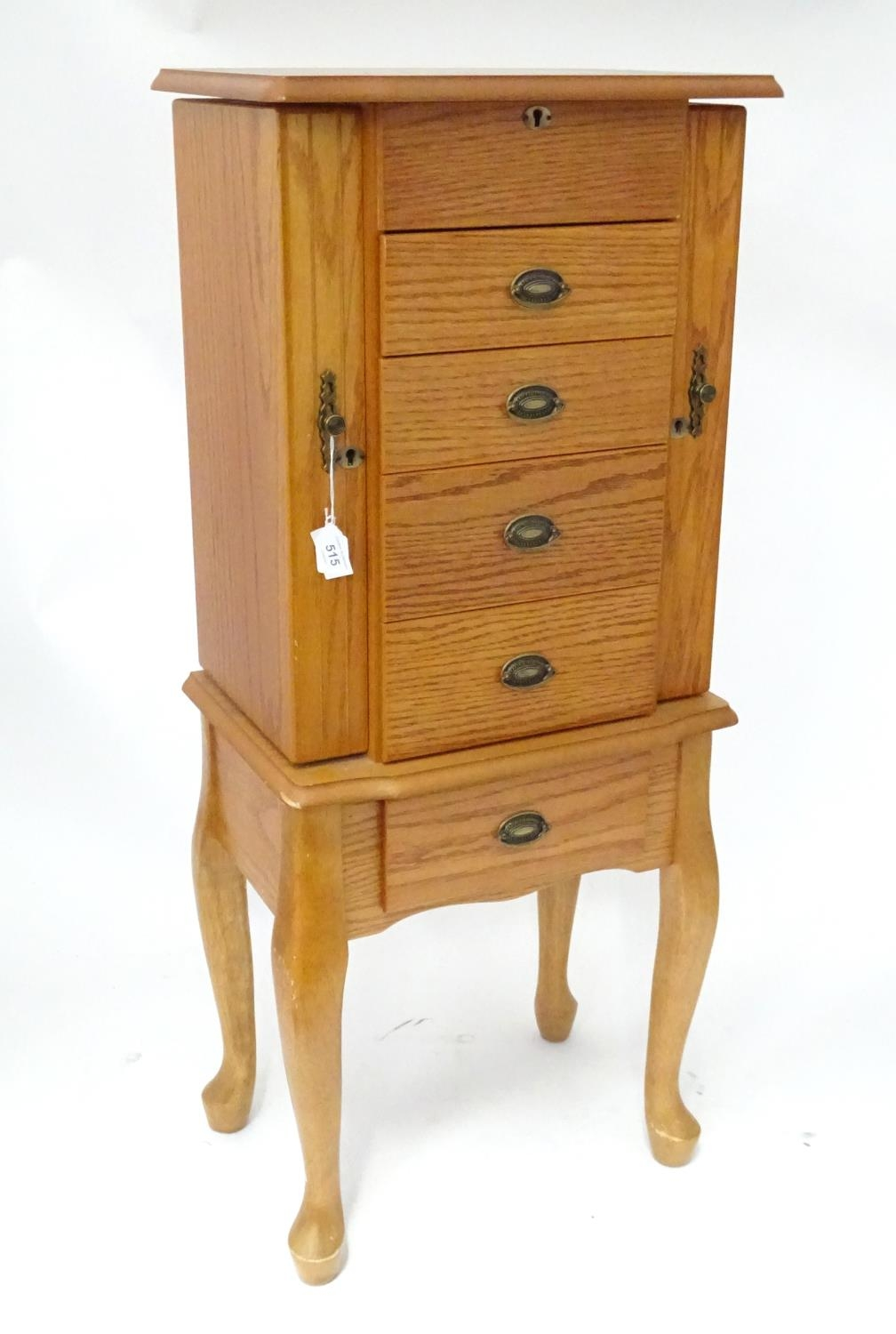 A jewellery cabinet Please Note - we do not make reference to the condition of lots within