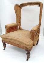 A late 19th / early 20thC wingback armchair Please Note - we do not make reference to the