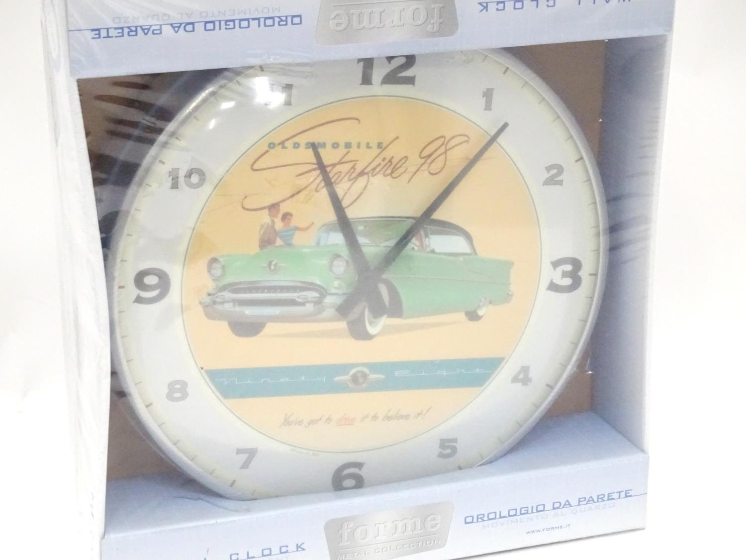 An American motoring wall clock decorated with the car / vehicle Oldsmobile Starfire '98 Please Note - Image 3 of 5