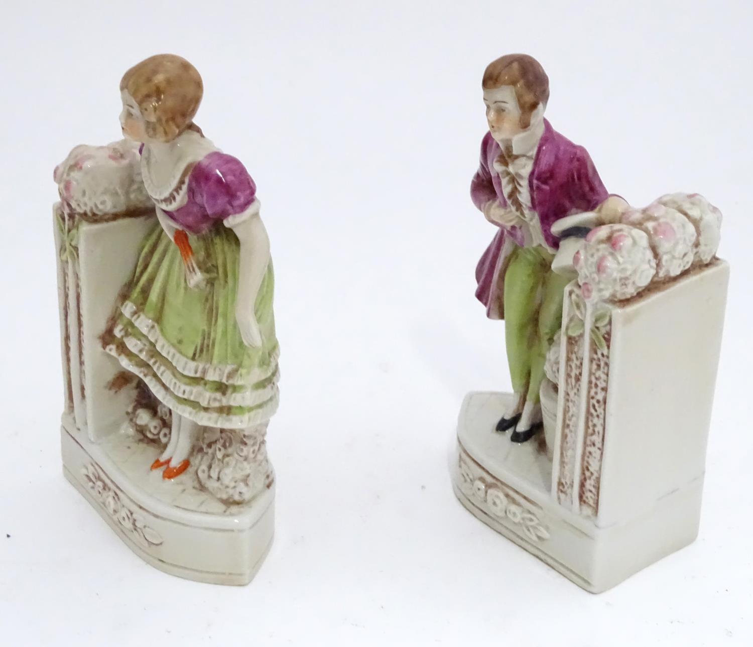 A pair of German porcelain figural bookends depicting a gentleman and a lady with flowers. Marked - Image 7 of 13