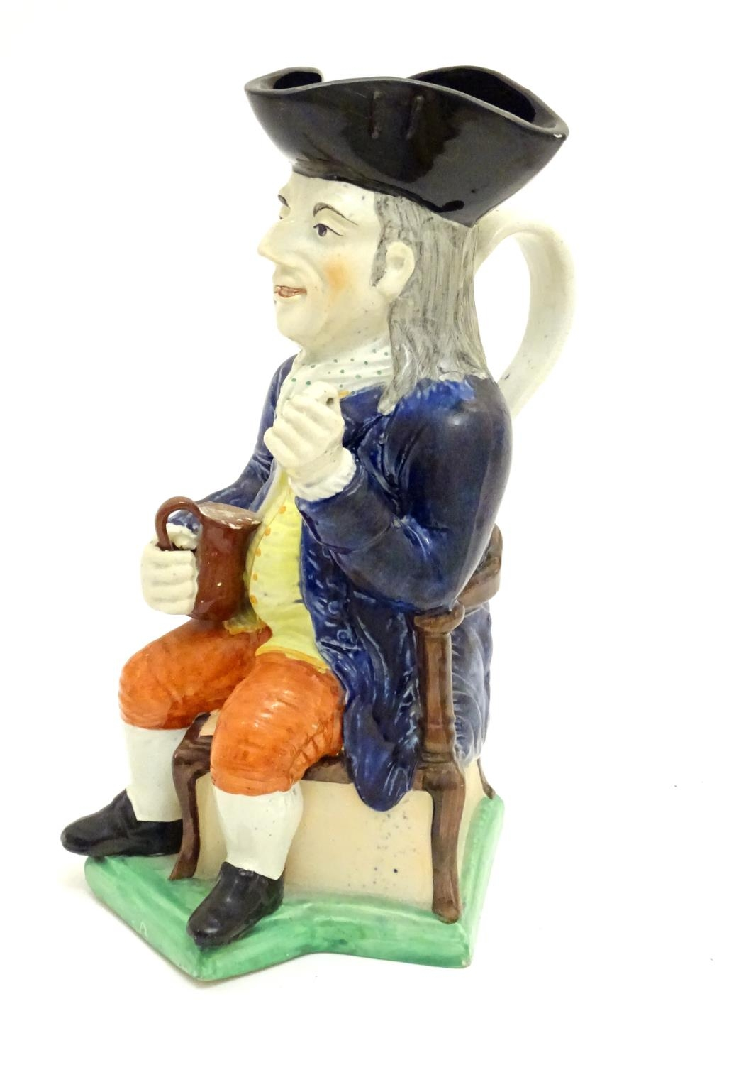 A large Toby jug formed as a seated gentleman in a tricorn hat with a tankard of ale. Approx. 10 3/