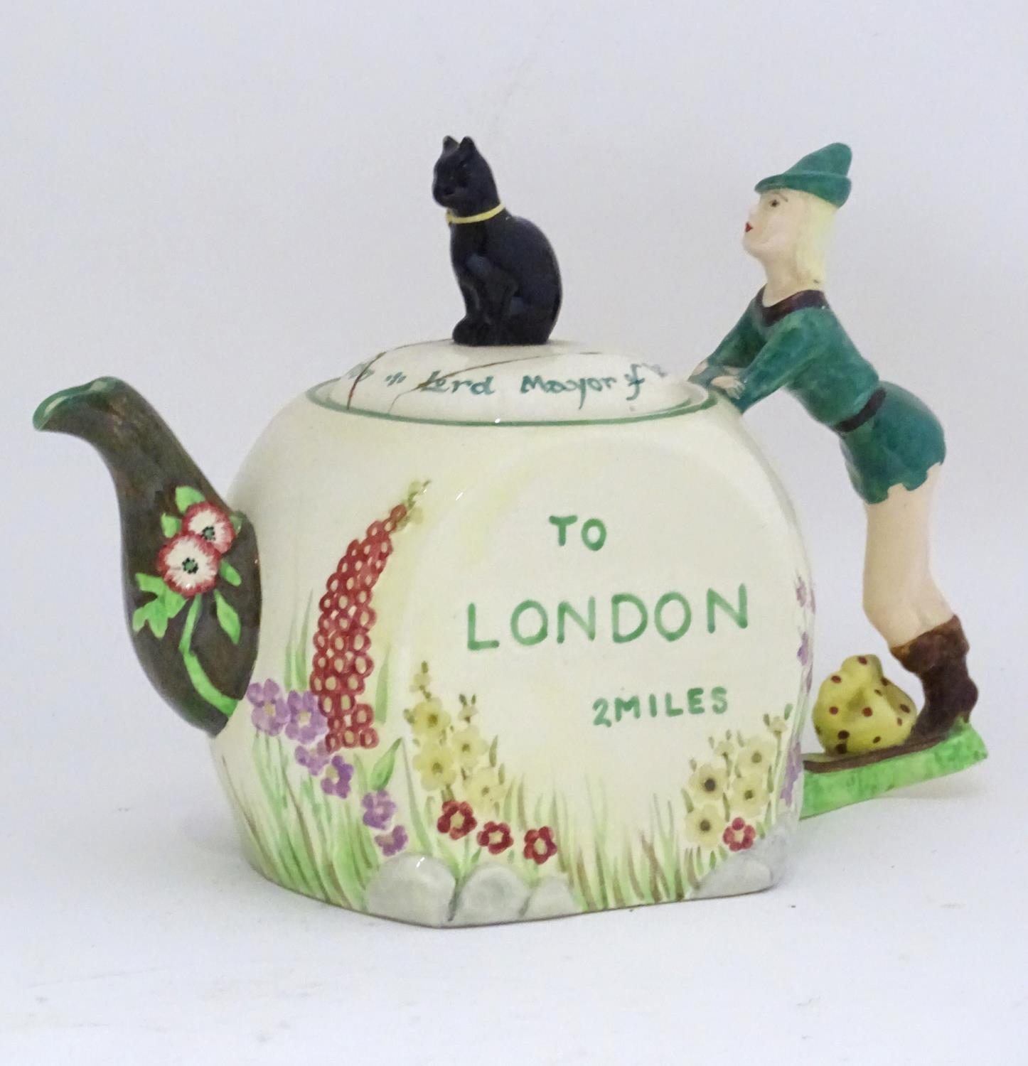 A novelty Dick Whittington teapot Please Note - we do not make reference to the condition of lots