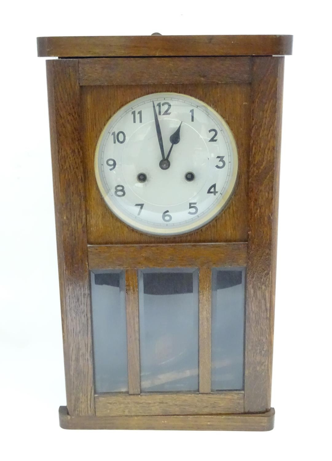 A 20thC English wall clock Please Note - we do not make reference to the condition of lots within