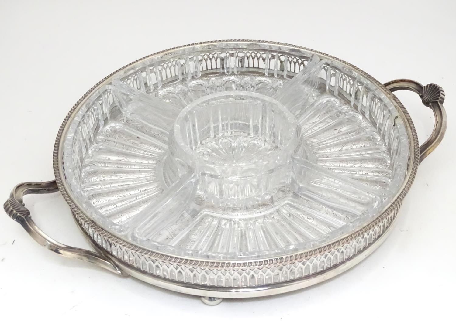A silver plated entree dish with 5 inset glass sections Please Note - we do not make reference to