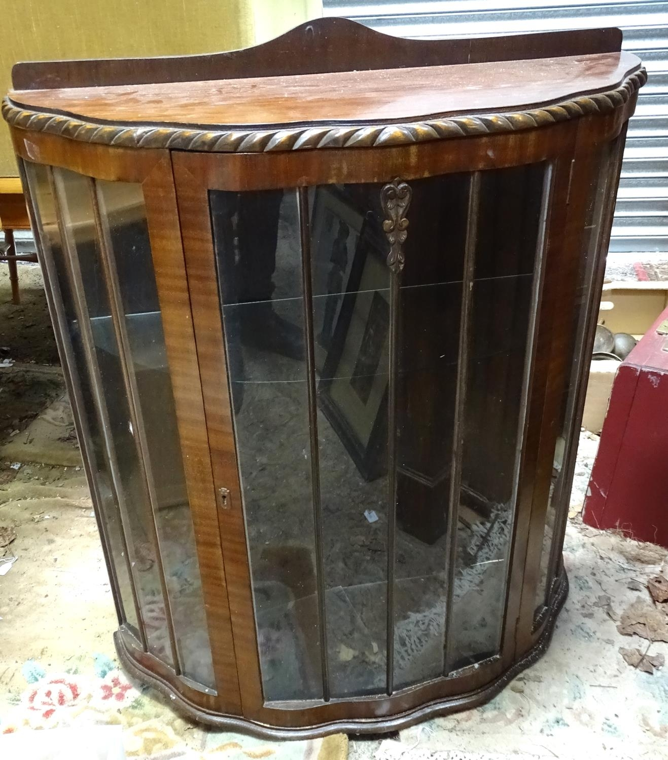 A demi lune glazed display cabinet Please Note - we do not make reference to the condition of lots