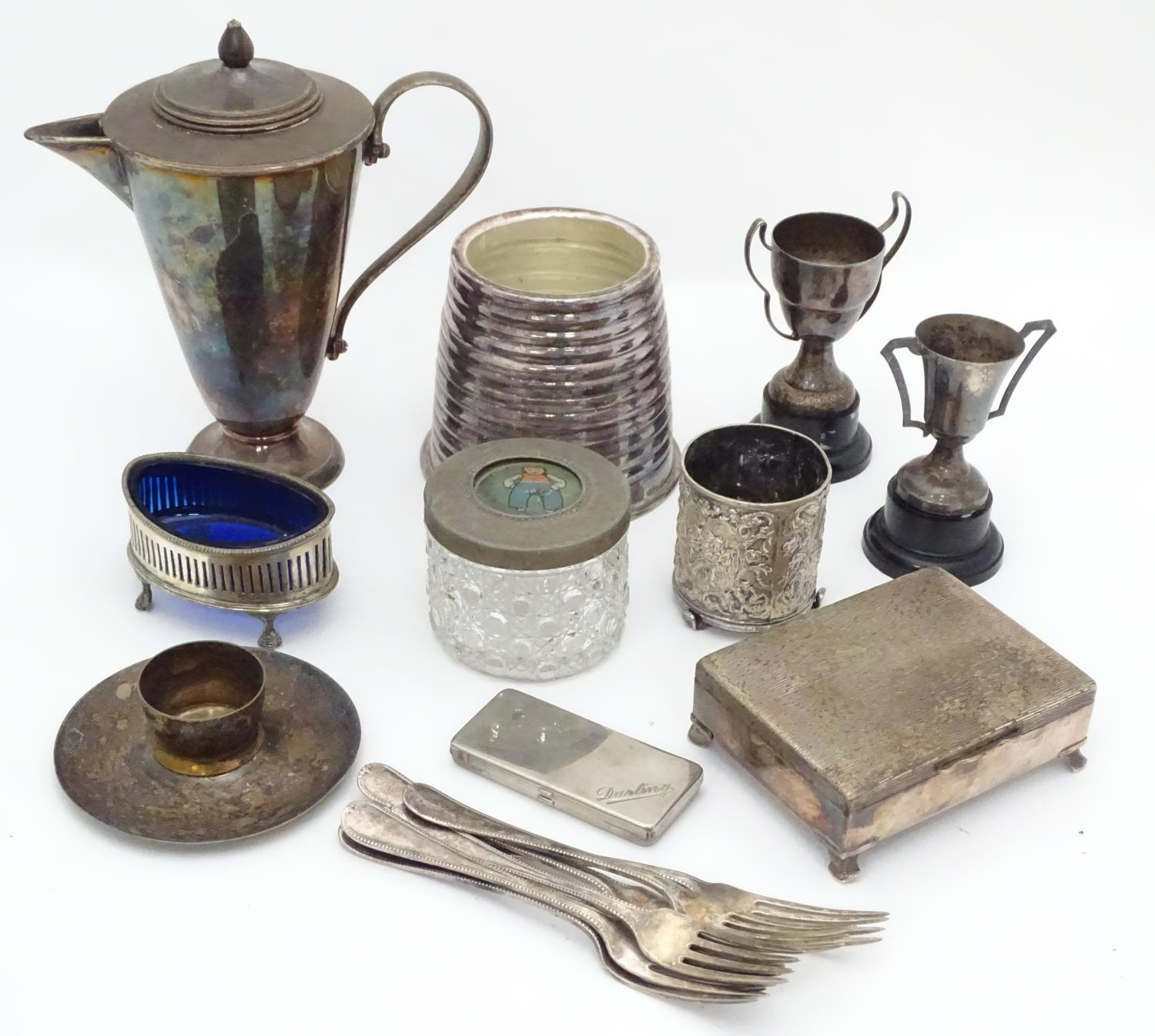 A quantity of silver plated items to include cutlery, cigarette box, trophy, coffee pot, candle