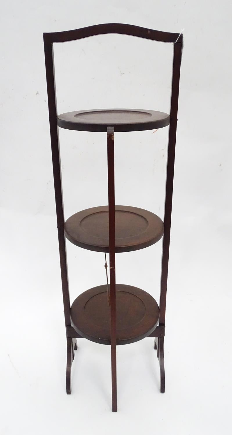 A mahogany folding cake stand with three tiers Please Note - we do not make reference to the - Image 2 of 3