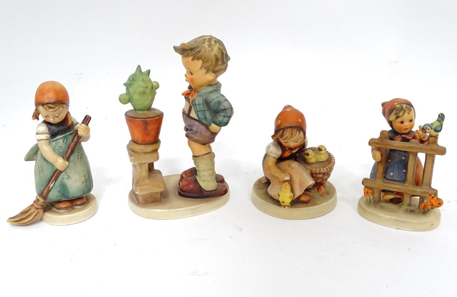 Four Hummel / Goebel figures Please Note - we do not make reference to the condition of lots
