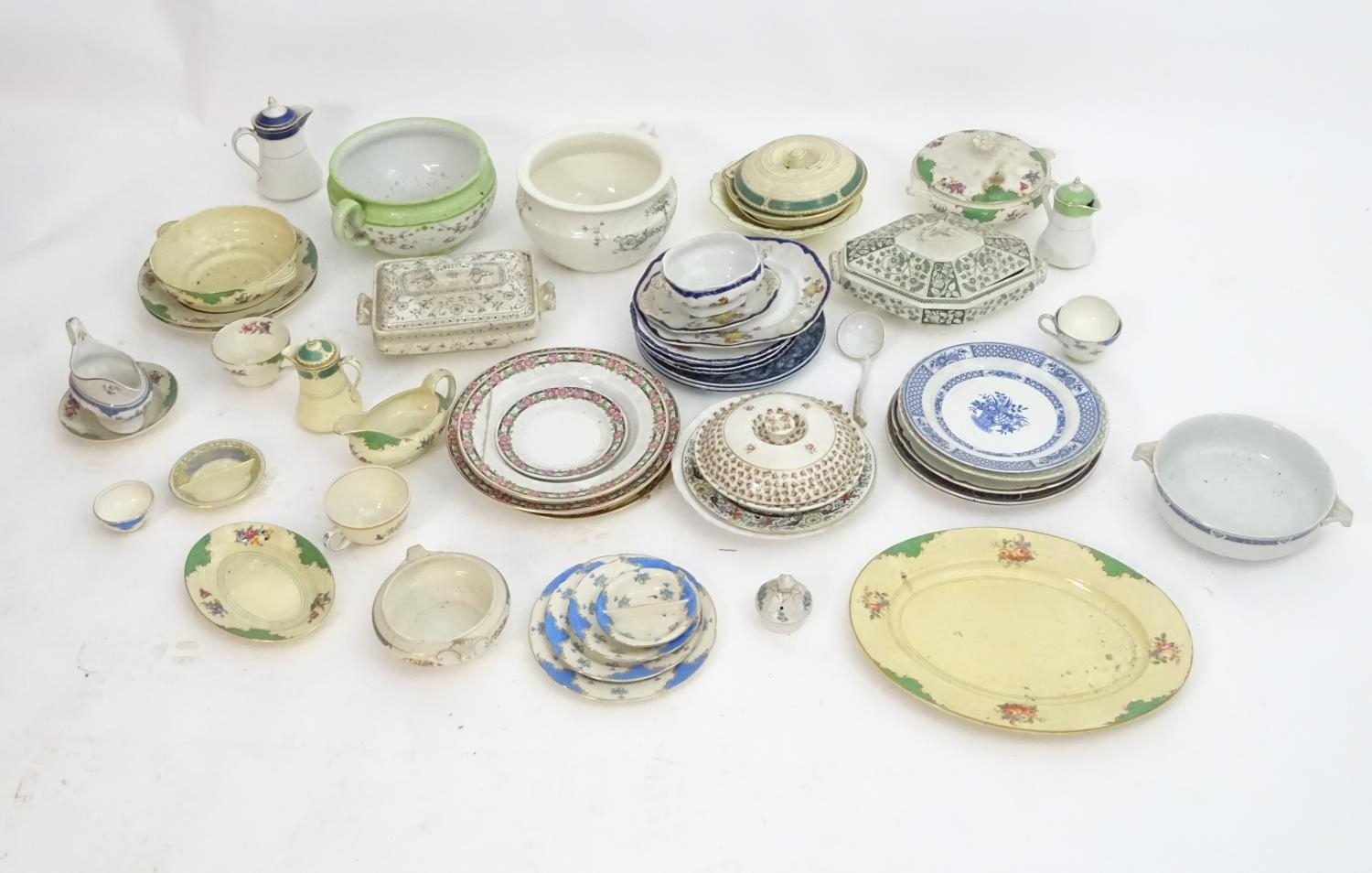 A large quantity of assorted Booths china to include bowls, coffee pots, chamber pots, cups,