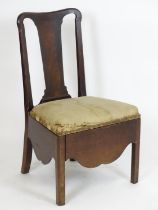 An 18thC mahogany side chair with a shaped top rail, vase shaped back splat and being raised on four