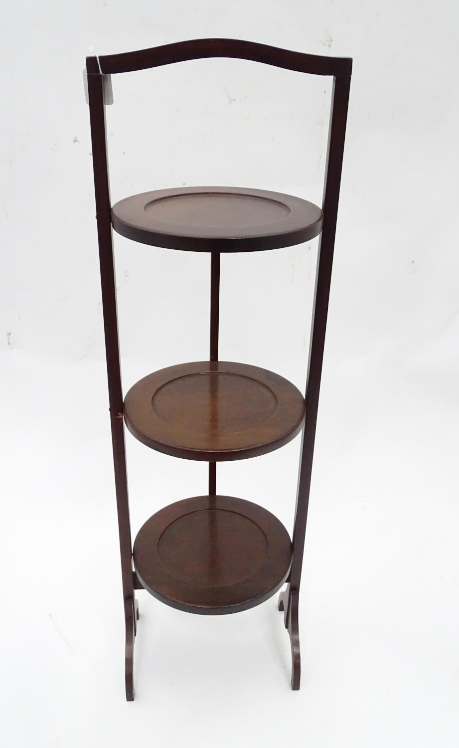A mahogany folding cake stand with three tiers Please Note - we do not make reference to the - Image 3 of 3