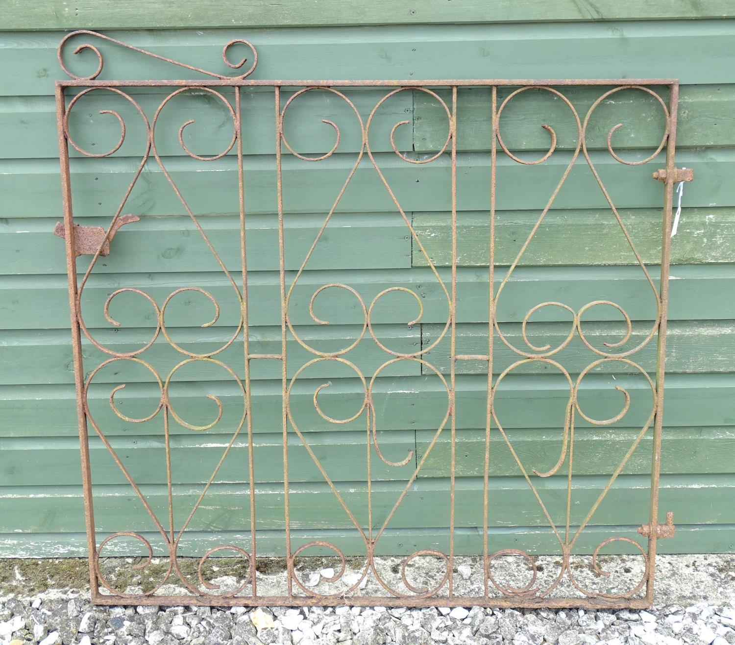 A wrought iron gate Please Note - we do not make reference to the condition of lots within